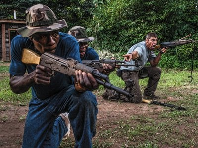 In the Democratic Republic of Congo, trainer Franck Canniet, far right, trains rangers for a confrontation with poachers.