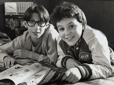 """Fred Savage (right) and Josh Saviano (left) of """"The Wonder Years"""" reunited at the American History Museum on December 2, 2014 to donate items, including the New York Jets jacket shown here in a publicity photo from around 1988."""