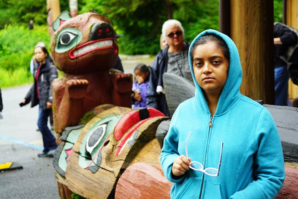My daughter with a Totem Pole in Ketchikan, Alaska thumbnail