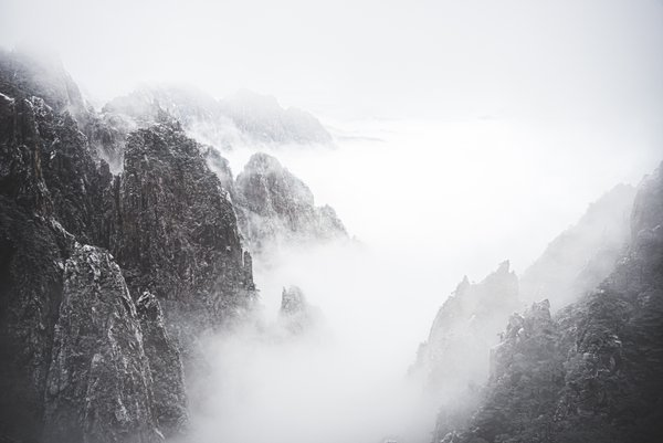 This photo was shot on a snowy day on the Huang Mountain near Anhui province. It was a very foggy day, and the mountain was showing off with lots white. It looked very much like a Chinese painting.
