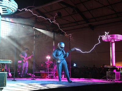ArcAttack's lightning guitarist wears a protective Faraday suit.