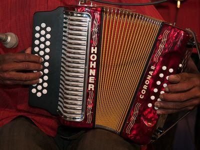 Mónico Márquez plays a Hohner button accordion with Venezuelan band Mestros del Joropo Oriental at the 2009 Smithsonian Folklife Festival.