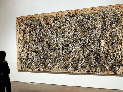 """A visitor to MoMA views Jackson Pollock's painting """"One (Number 31, 1950)"""""""
