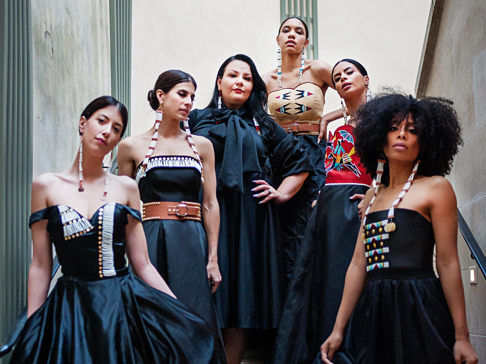 Norma Baker–Flying Horse (third from left) with models wearing her Red Berry Woman designs. Paris Fashion Week, March 2019. (Ulla Couture Photography)