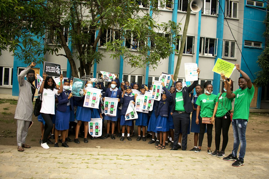 group of students holding up different signs for the UN's sustainable development goals