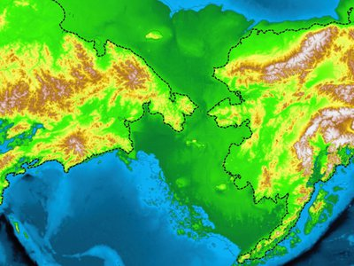 Russia and Alaska's current coastlines (the dashed black lines), compared to ancient Beringia (shown in green), the land bridge that brought humans to North America.