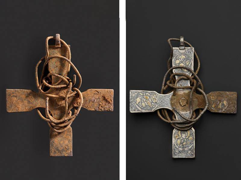 Left, a square cross wrapped in what looks like metal wire; totally encrusted with reddish brown dirt; right, 3 of four arms of the cross have been cleaned, to reveal intricate engravings underneath