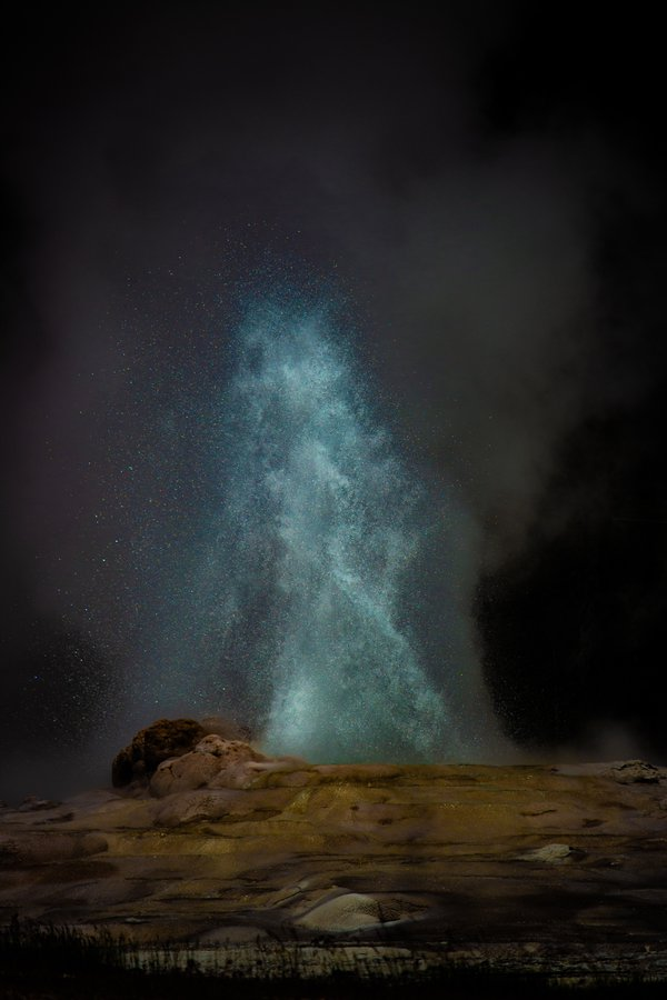 A midday eruption of the Old Faithful Geyser at Yellowstone National Park. thumbnail