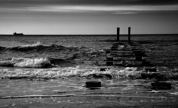 Seascape juxtapositions in time in black and white thumbnail