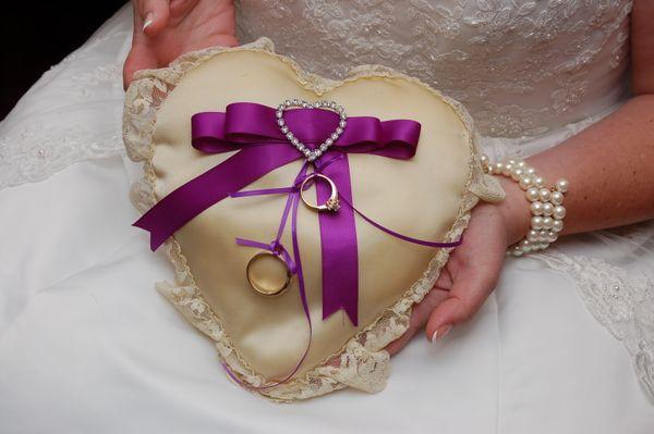 Preparing the pillow for the ring-bearer. thumbnail