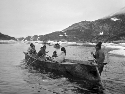 Modern-day Canadian Inuit pictured in their traditional boats (umiak), used for hunting and  transportation.