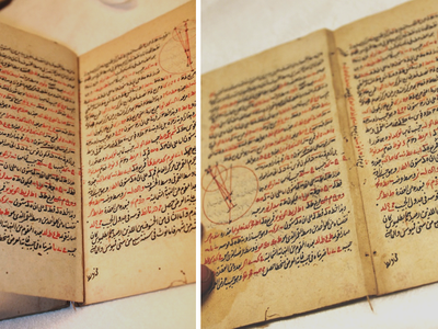 An annotated note hidden in the margins of an 18th-century mathematical manuscript by a past restoration attempt.