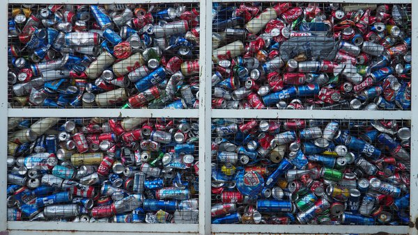 Grated truck full of empty cans in El Paso. thumbnail