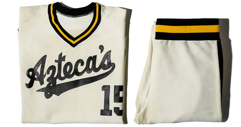 """White jersey with green and yellow trim reading """"Aztecas"""""""