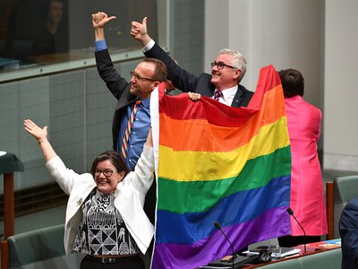 Members of parliament react to the passage of the Marriage Amendment Bill, from left to right, Cathy McGowan, Adam Brandt and Andrew Wilkie.