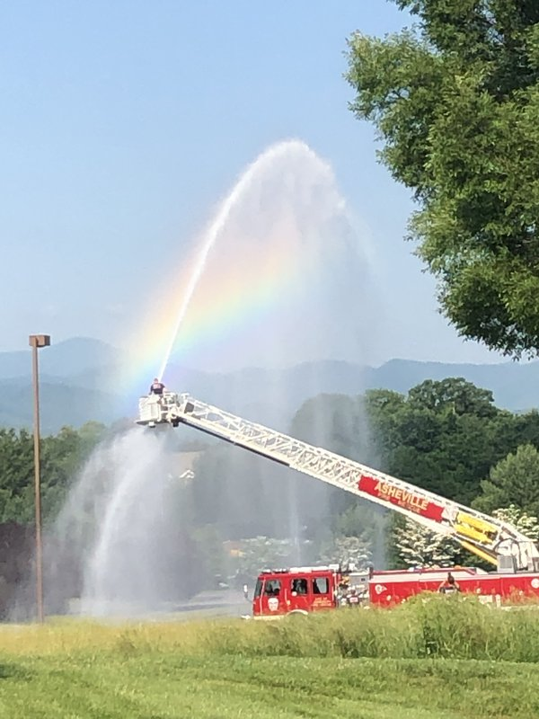 Firefighter with rainbow and mountain backdrop thumbnail