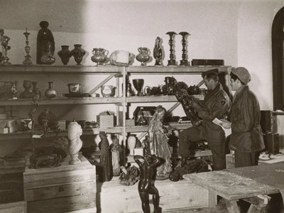 American soldiers sift through art looted by the Nazis at Neuschwanstein Castle in 1945