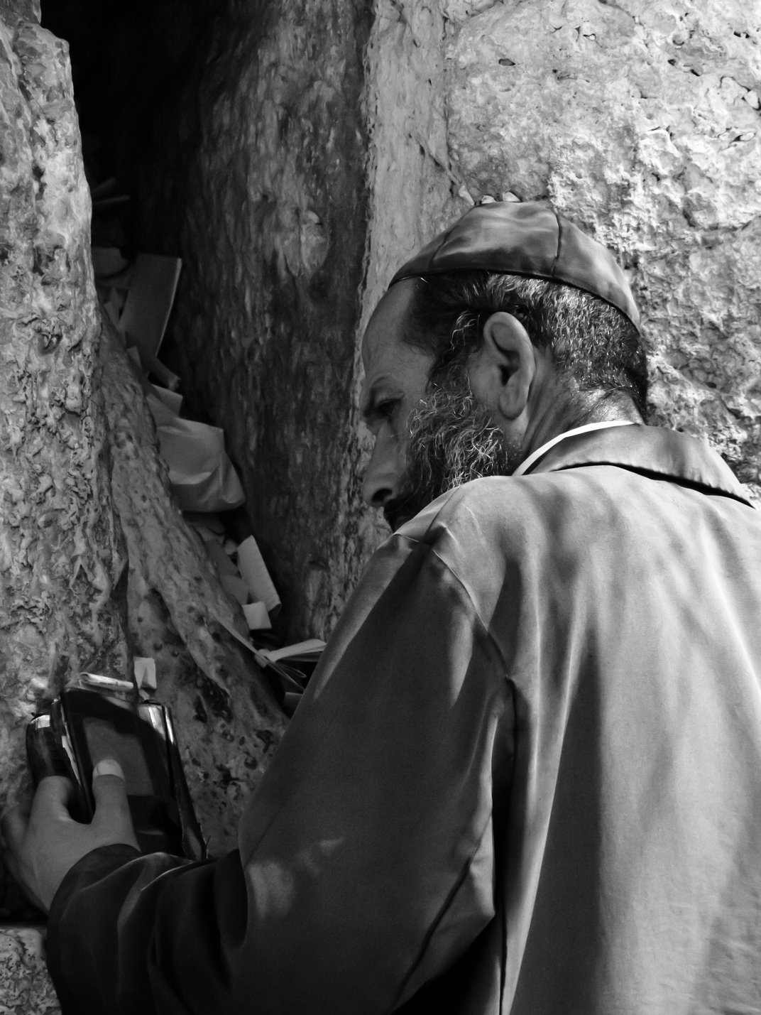 Religious Man Preparing For Prayer At The Western Wall In