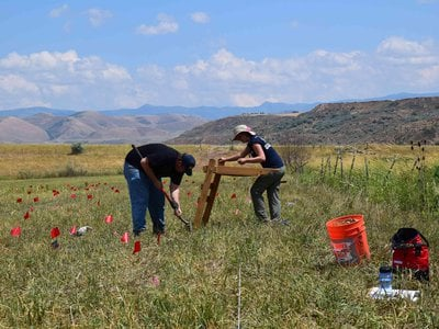 Archaeologists look for pieces of metal in their search for the remains of a massacre of Native Americans in 1863 in Idaho.