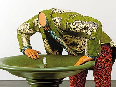 Artist Yinka Shonibare's Headless Man Trying to Drink sculpture alludes to the growing shortage of potable water worldwide.