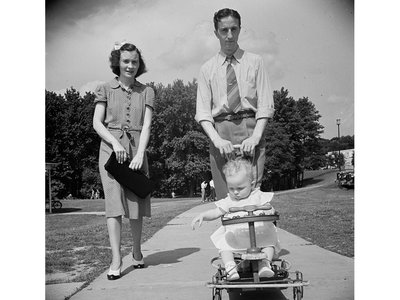 A family practicing the art of sauntering on a Sunday in 1942 in Greenbelt, Maryland.
