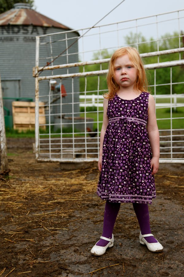 Samantha, on her farm in Connorsville, WI.  She was dressed in her Sunday best and taking me into the barn to see her 13 newborn pigglets. thumbnail