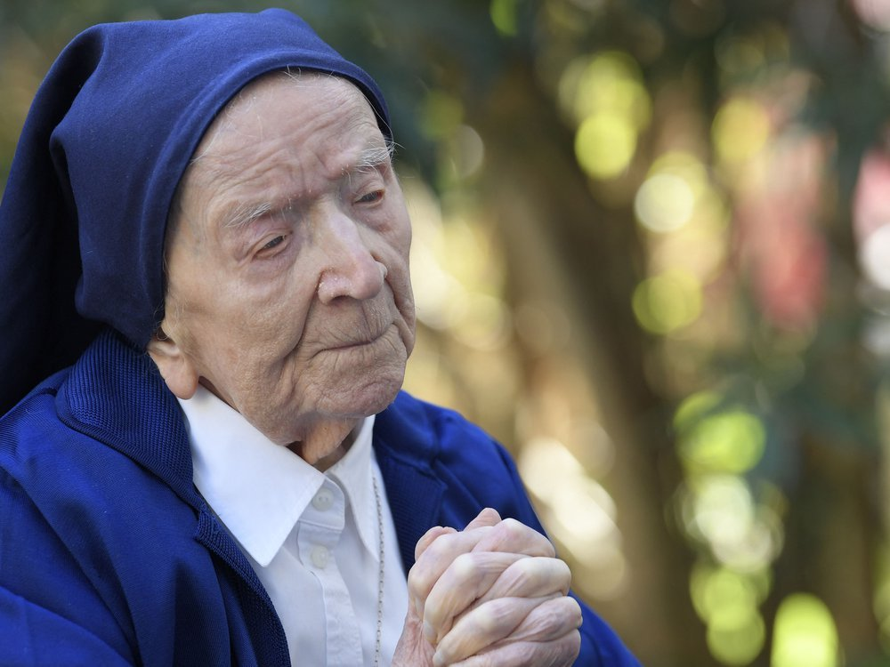 Sister Andre, Lucile Randon in the registry of birth, the eldest French and European citizen, prays in a wheelchair, on the eve of her 117th birthday
