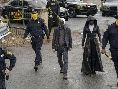 """In a scene from the HBO series, Tulsa's masked police force prepares for a raid. Detective Wade Tillman (known as """"Looking Glass"""") is played by Tim Blake Nelson. Detective Angela Abar (known as """"Sister Night"""") is played by Regina King (Mark Hill for HBO)."""