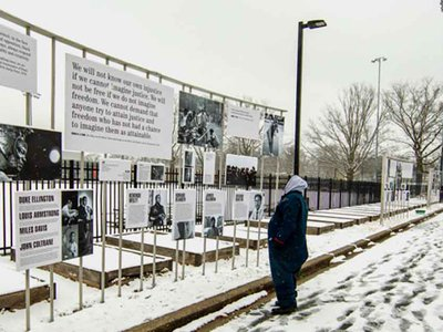 """The exhibition is on view near a neighborhood recreation center that holds classes and homework time, even during the pandemic, and an all-boys high school. """"I just feel like this block amplifies all of the messages expressed in the exhibit,"""" says one of the show's organizers."""