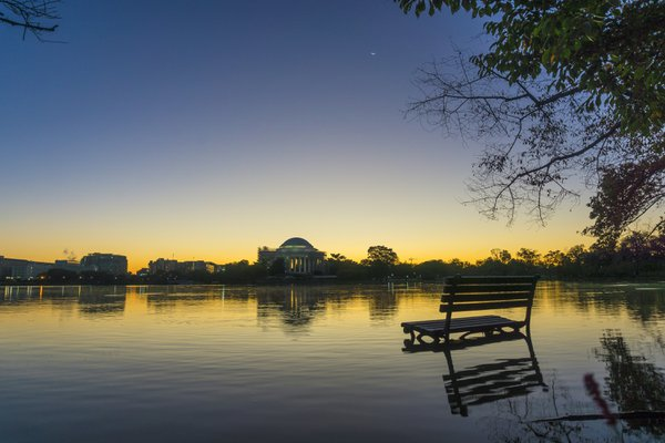 A crescent moon at sunrise over a flooded Tidal Basin in Washington, DC thumbnail