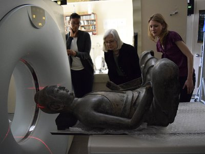 """The Freer Buddha undergoes a CT scan at the National Museum of Natural History. """"He wouldn't relax his legs,"""" Donna Strahan recalls with a laugh."""