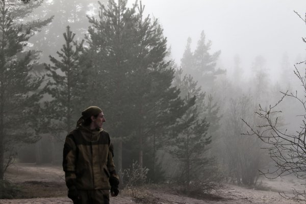 A man looking into the distance on a foggy shore thumbnail
