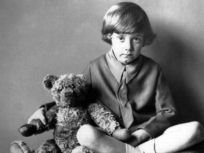 Christopher Robin Milne (1920-1996) son of author A.A. Milne photographed in 1928 with the bear who became Winnie the Pooh