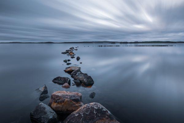 Half-submerged rocks at Lake Runn, Sweden thumbnail