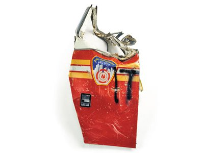 More than 50 artifacts from the September 11 attacks, including Fire Truck Door, 2001, will be displayed at the American History Museum.