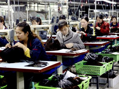 Female workers make wigs to be exported at a hair products factory in China's Sichuan province.
