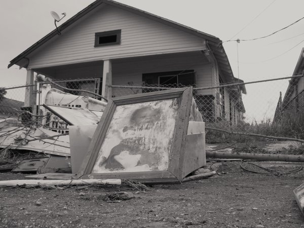 Belongings of a small family home after Hurricane Katrina ripped through the 9th Ward. thumbnail