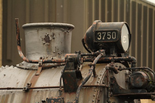 A rusty, weathered steam locomotive thumbnail