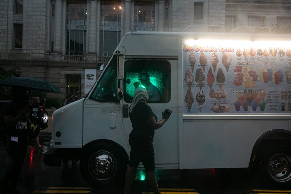 Ice cream truck vendor gives thumbs up to demonstrators thumbnail