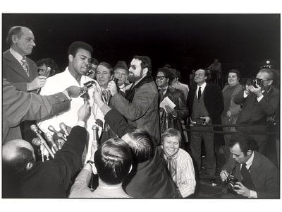 Muhammad Ali speaks during a press conference held before his fight against Argentina's Oscar Bonavena.