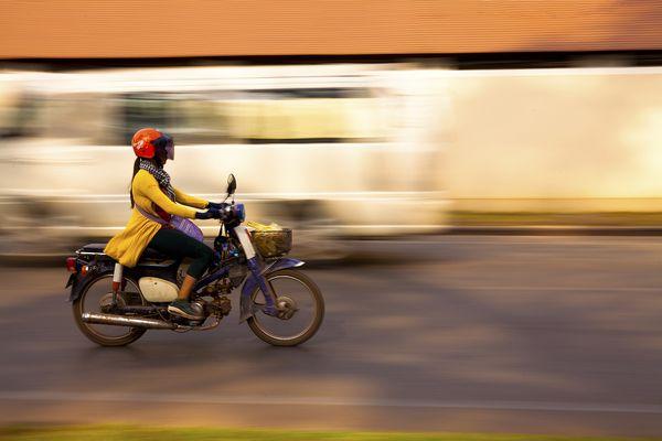 Girl on Motorbike in Siem Reap, Cambodia thumbnail