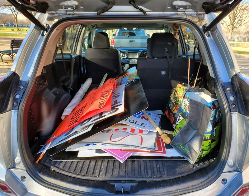 The open trunk of a car filled with collected items