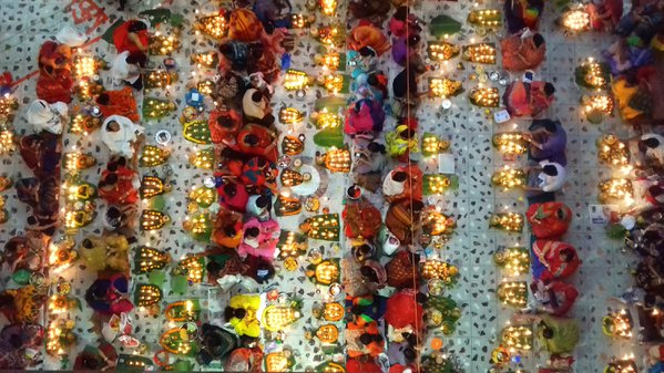 Hindu prayers in a Fasting and Lighting of Lamps festival thumbnail
