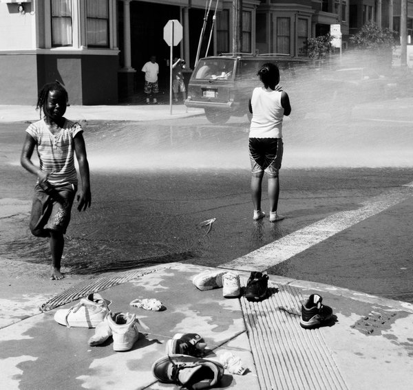 Two girls get relief from an uncharacteristically hot day in San Francisco. thumbnail