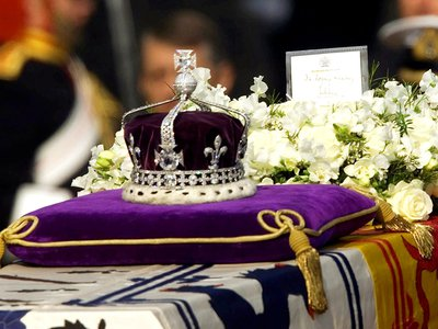 The Koh-i-Noor diamond set at the front of the crown made for the Queen Mother Elizabeth, set on her coffin in April 2002.