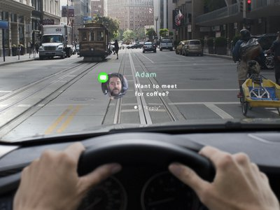 A rendering illustrates how messages will appear in mid-air using Navdy's new dashboard head-up display.