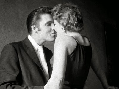 The Kiss In the privacy of the narrow hallway under the fire stairs of the Mosque Theater, while other performers are on stage before 3,000 fans in the audience, Elvis is concentrating on his date for the day.