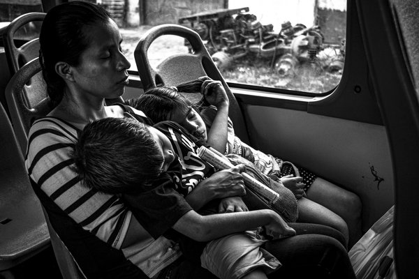 Mother and her children in a Metro Bus thumbnail