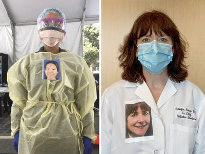 Health care workers at Stanford and the University of Massachusetts who have placed smiling portraits of themselves on the outside of their protective gear