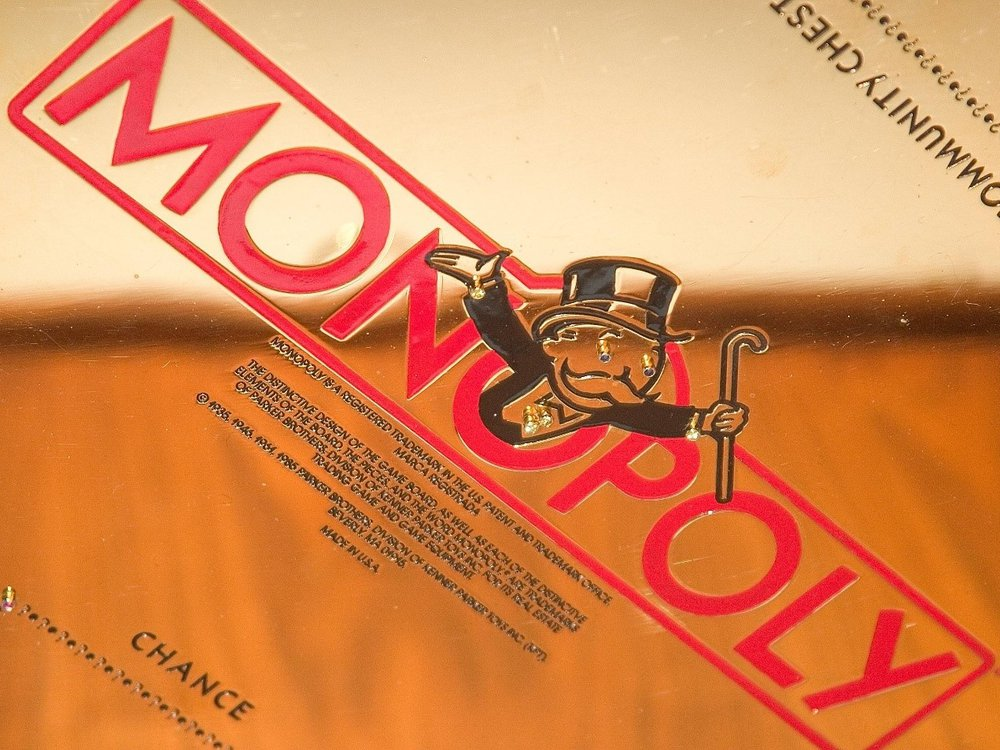 Artist and Jeweler Sidney Mobell donated his gold-plated Monopoly set to the National Museum of Natural History in 2002. (Smithsonian Institution)